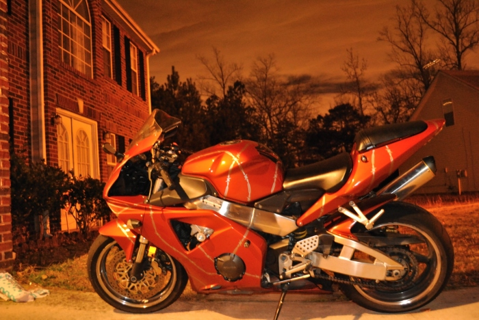 My personal Honda CBR 954 RR...father's day gift to myself a few years back.  Captured this shot with the Nikon one evening after sunset.  No editing, no lie. hint...garage lighting :)